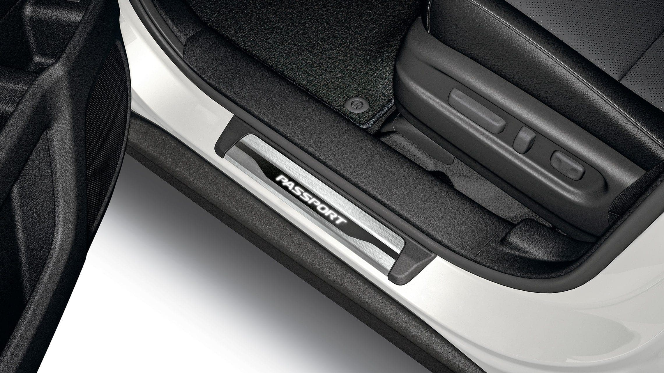 Detail of accessory illuminated door sill trim on the 2019 Honda Passport.