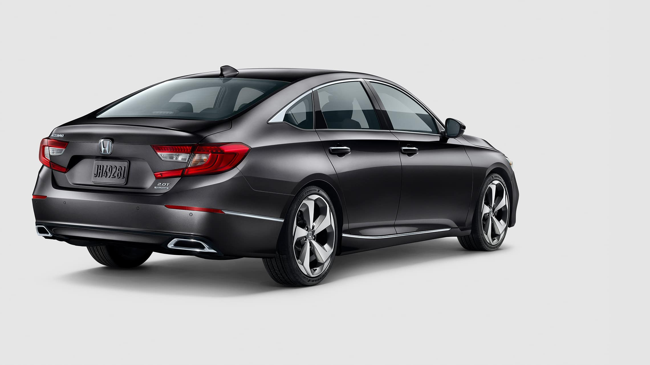 Rear passenger-side view of 2020 Honda Accord Touring 2.0T in Modern Steel Metallic.