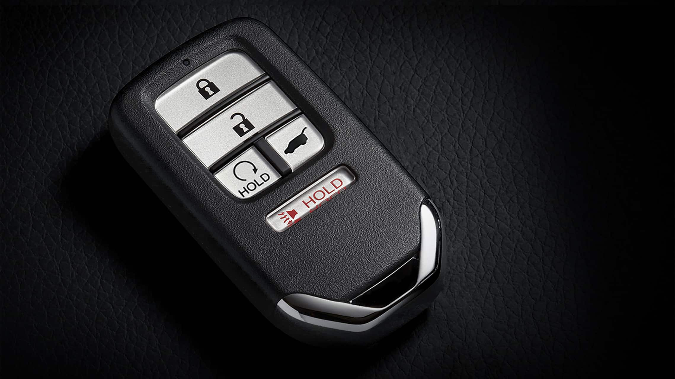 Key fob with remote engine start button detail for 2020 Honda Civic Sport Touring Hatchback.
